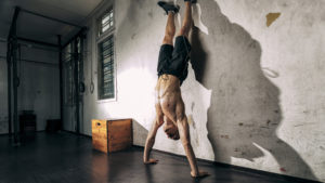Man doing hand stand exercise