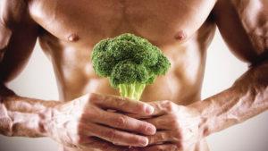 Healthy man holding broccoli