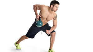 Man exercising with kettlebells