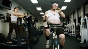 Man Eating While Exercising