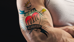 Toxic relationship tattoo on a man's bicep